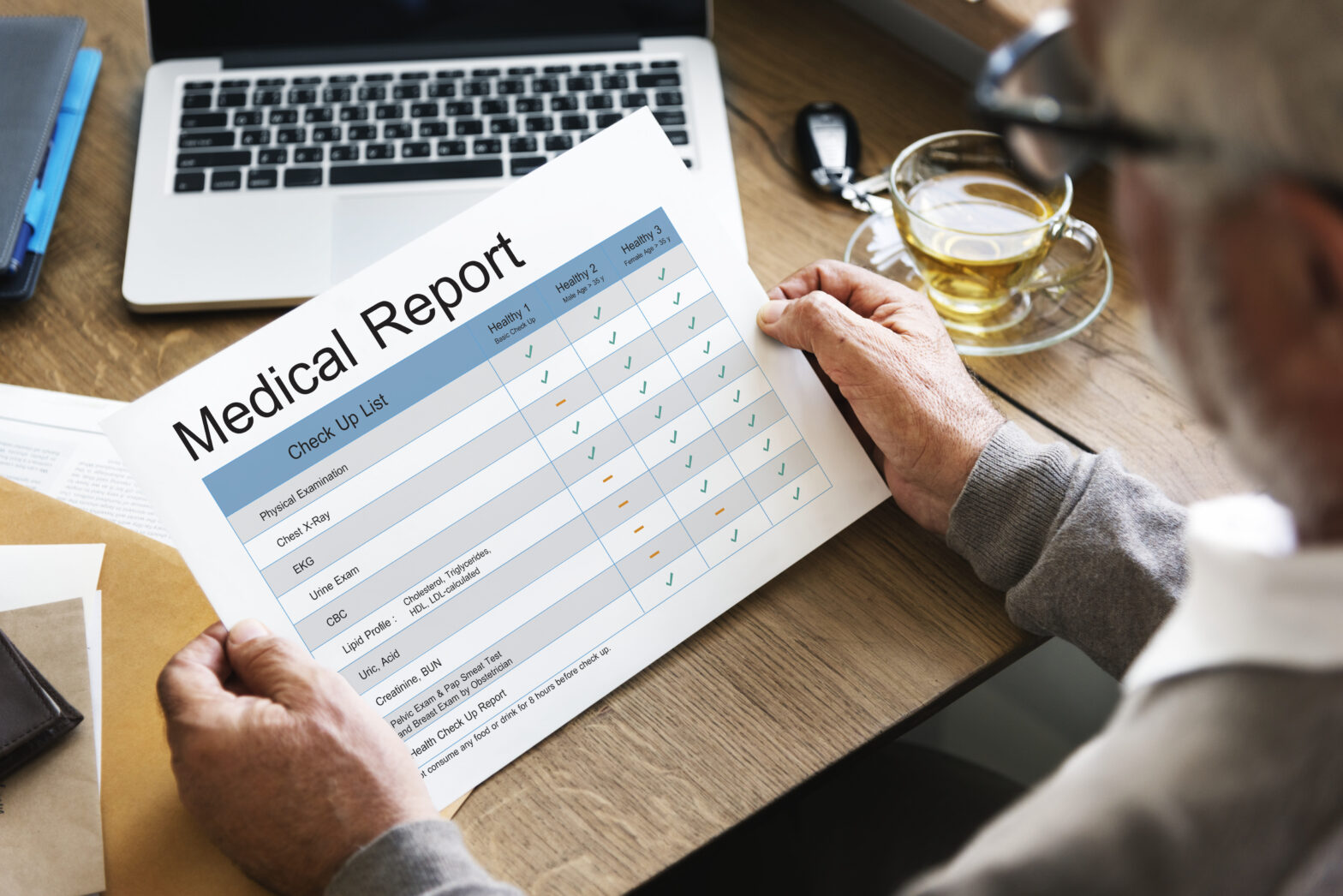 As a result of health screening, the patient is reading the medical report.